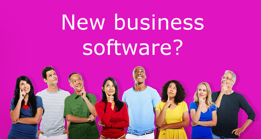 Picture of People Looking up at a new software banner. DGG helps with new software.